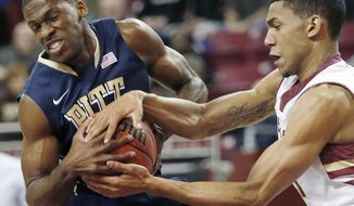 Pittsburgh's Josh Newkirk (13) and Boston College's Olivier Hanlan (21) struggle for the ball during the first half of an NCAA college basketball game in Boston, Wednesday, Feb. 26, 2014. (AP Photo/Michael Dwyer)