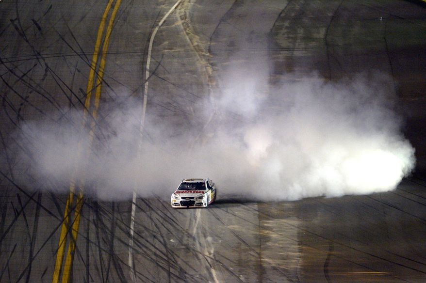 10ThingstoSeeSports - Dale Earnhardt Jr. emerges from a cloud of smoke after winning the NASCAR Daytona 500 auto race at Daytona International Speedway in Daytona Beach, Fla., Sunday, Feb. 23, 2014. (AP Photo/Phelan M. Ebenhack, File)