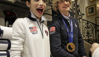 Olympic figure skating gold medalists Meryl Davis and Charlie White talk to fans while signing autographs in New York, Wednesday, Feb. 26, 2014. (AP Photo/Seth Wenig)