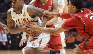 Illinois' Ravonte Rice tries to keep a grip on the ball as Nebraska's Shavon Shields (31) makes a grab while Nebraska's Terran Petteway and Illinois' Maverick Morgan (22) watch during the first half of an NCAA college basketball game in Champaign, Ill., on Wednesday, Feb. 26, 2014. (AP Photo/Heather Coit)