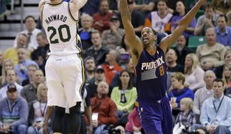 Utah Jazz's Gordon Hayward (20) shoots as Phoenix Suns' Channing Frye (8) defends in the second quarter of an NBA basketball game on Wednesday, Feb. 26, 2014, in Salt Lake City. (AP Photo/Rick Bowmer)