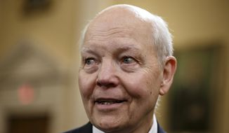 Internal Revenue Service (IRS( Commissioner John Koskinen arrives on Capitol Hill in Washington, Wednesday, Feb. 5, 2014, to testify before the House Ways and Means Oversight Subcommittee hearing on the IRS.  (AP Photo/J. Scott Applewhite)