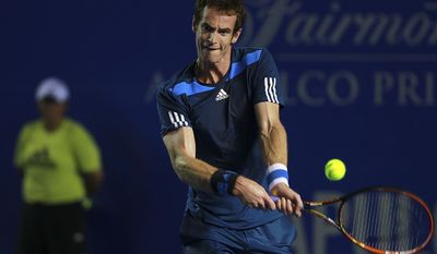 Britain's Andy Murray returns the ball while playing against Spain's Pablo Andujar during a match of the Mexican Tennis Open championship in Acapulco, Mexico, Tuesday Feb. 25, 2014. (AP Photo/Jam Media, Hugo Avila)