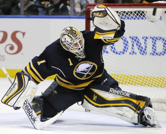 Buffalo Sabres' Jhonas Enroth, of Sweden, eyes the puck as he makes a save from a Boston Bruins shot during the second period of an NHL hockey game in Buffalo, N.Y., Wednesday, Feb. 26,  2014. Buffalo won 5-4 in overtime. (AP Photo/Gary Wiepert)