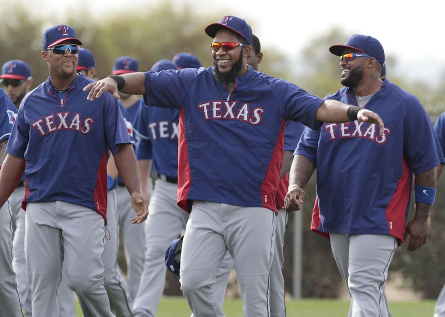 Texas Rangers infielders Adrian Beltre, left, and Prince Fielder, right, are entertained by Elvis Andrus during warm ups at baseball spring training camp in Surprise, Ariz., on Friday, Feb. 21, 2014. (AP Photo/The Fort Worth Star-Telegram, Ron T. Ennis)  MAGS OUT; (FORT WORTH WEEKLY, 360 WEST); INTERNET OUT