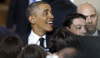 """President Barack Obama greets people  at the Union Depot in St. Paul, Minn., Wednesday, Feb. 26, 2014, after he announced a new competition encouraging investments for job creation and infrastructure as part of his """"Year of Action."""" (AP Photo/Jim Mone)"""