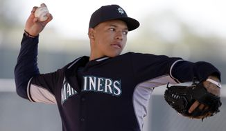 Seattle Mariners pitcher Taijuan Walker throws in a bullpen session during spring training baseball practice, Thursday Feb. 20, 2014, in Peoria, Ariz. (AP Photo/Tony Gutierrez)