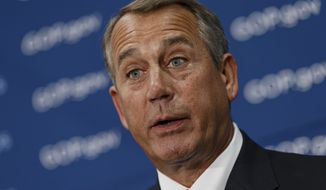 House Speaker John Boehner of Ohio meets with reporters on e Capitol Hill in Washington, Wednesday, Feb. 26, 2014, following a Republican caucus. When asked about House Ways and Means Committee Chairman Rep. Dave Camp, R-Mich., and his plan to release a rewrite of the nation's tax code later today, Boehner distanced himself from the details and wouldn't promise a House vote on the plan this year.   (AP Photo/J. Scott Applewhite)