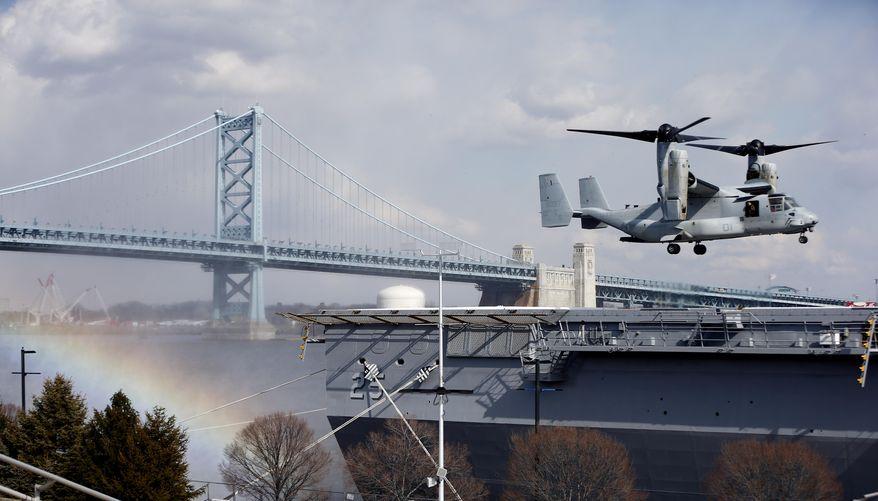 ** FILE ** A Marine Osprey lands aboard the USS Somerset in view of the Benjamin Franklin Bridge, Thursday, Feb. 27, 2014, in Philadelphia. (AP Photo/Matt Rourke)