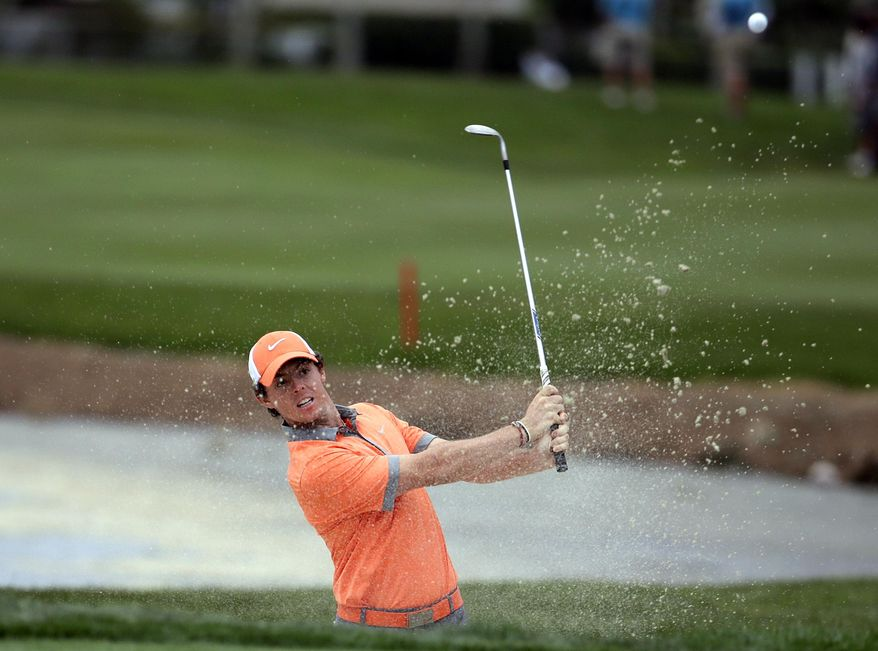 Rory McIlroy, of Northern Ireland, hits out of a bunker onto the 18th green during the first round of the Honda Classic golf tournament, Thursday, Feb. 27, 2014, in Palm Beach Gardens, Fla. McIlroy ended the day at 7 under par. (AP Photo/Lynne Sladky)