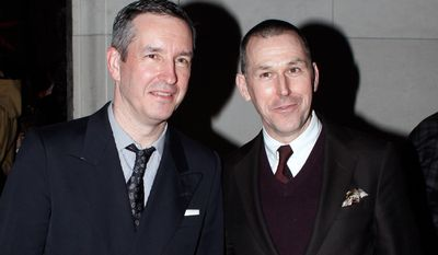 "Designers Dries Van Noten, left, and Mark Lee, pose for photographers during the ""Dries Van Noten Inspiration"" exhibition, in Paris, Thursday, Feb.27, 2014. (AP Photo/Thibault Camus)"