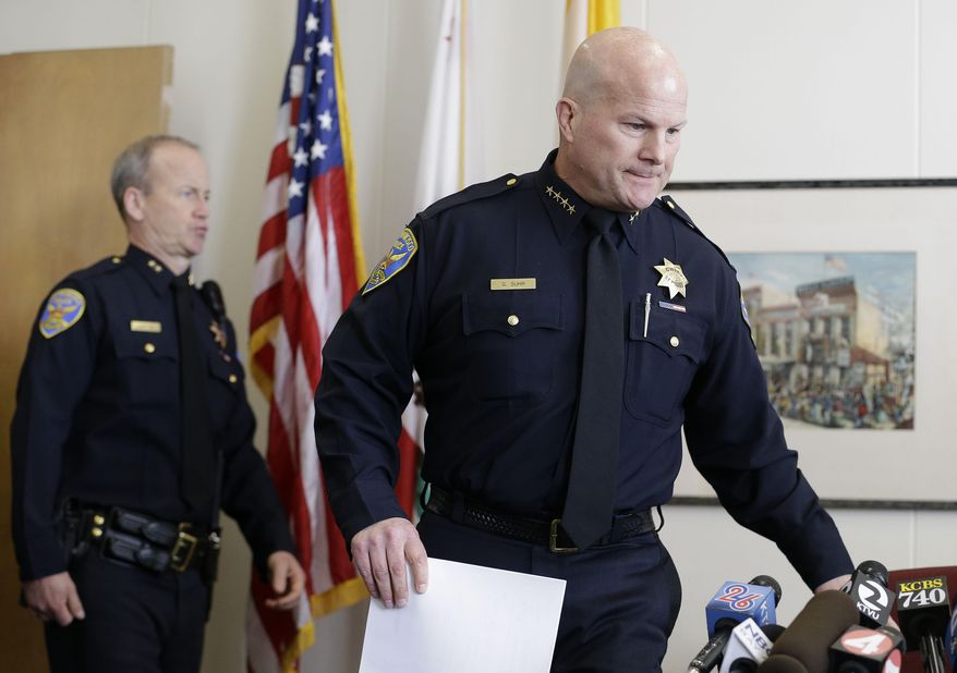 San Francisco Police Chief Greg Suhr, right, walks to a news conference at the Hall of Justice in San Francisco, Thursday, Feb. 27, 2014. Federal grand juries have indicted five San Francisco police officers, with two charged with stealing money and drugs seized as part of investigations, federal prosecutors announced on Thursday. Those two officers and a former officer were also charged with distributing controlled substances and stealing computers, electronic devices and gift cards from suspects. (AP Photo/Jeff Chiu)