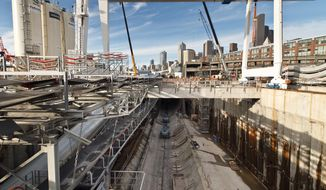 In this Feb. 25, 2014 photo provided by the Washington Dept. of Transportation, the launch pit that was used to start the massive tunneling machine being used to dig a waterfront tunnel to replace the Alaskan Way Viaduct in Seattle is shown. WSDOT says that over the next couple of weeks, workers will be making room for construction of the double-decker highway inside the tunnel. (AP Photo/Courtesy Washington Dept. of Transportation)