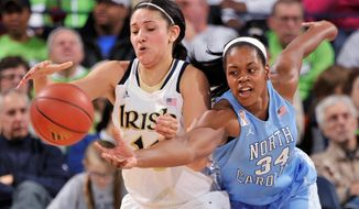 Notre Dame Natalie Achonwa, left, has the ball knocked away from her North Carolina forward Xylina McDaniel during the first half of an NCAA college basketball game, Thursday, Feb. 27, 2014 in South Bend, Ind. (AP Photo/Joe Raymond)