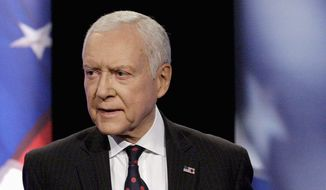 "Sen. Orrin Hatch, Utah Republican, said ""this isn't right and has to be stopped"" as America's Health Insurance Plans reported that Obamacare cuts would trim payment rates to Medicare Advantage plans by nearly 6 percent in 2015. (Associated Press photographs)"
