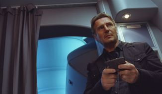 "Liam Neeson plays a grizzled federal air marshal tasked with protecting the passengers on a flight in ""Non-Stop."" (Universal Pictures/Associated Press)"