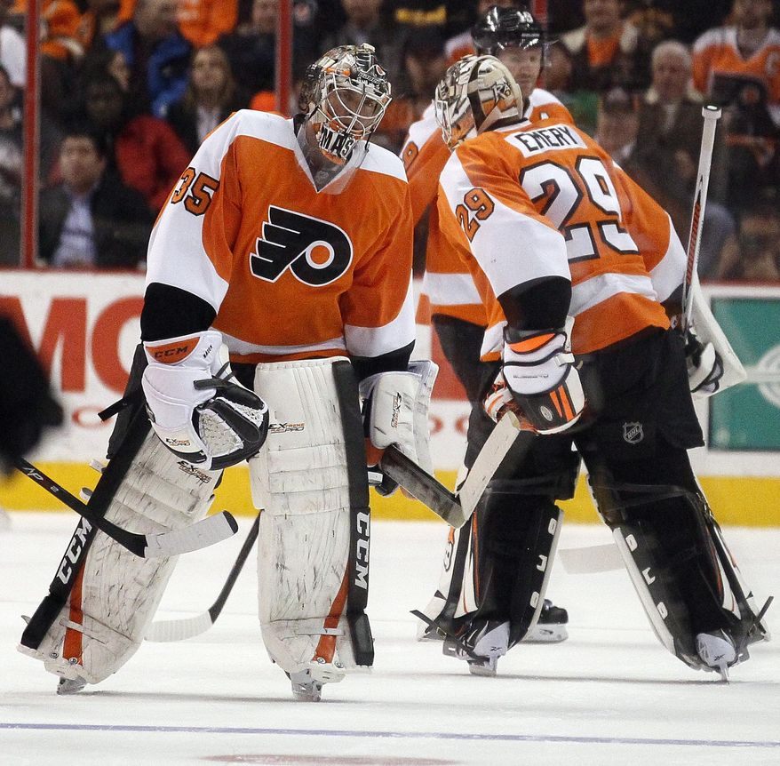 Philadelphia Flyers goalie Steve Mason, left, is replaced by Ray Emery, right, after the San Jose Sharks scored their fourth goal of an NHL hockey game during the second period on Thursday, Feb. 27, 2014, in Philadelphia. (AP Photo/Tom Mihalek)