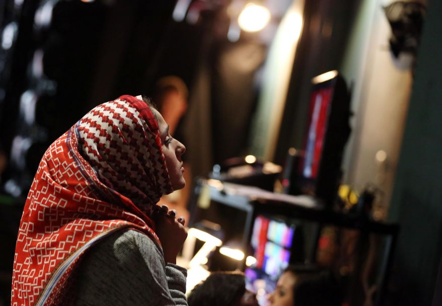 Zaineb Abdul-Nabi, 22, is seen backstage during rehearsals for the 86th Academy Awards in Los Angeles, Wednesday, Feb. 26, 2014. Abdul-Nabi was among the six aspiring young filmmakers selected from colleges across the country that will be handing Oscar statuettes to the stars presenting them on Sunday, March 2, 2014. (Photo by Matt Sayles/Invision/AP)