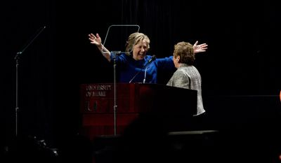Former secretary of state Hillary Clinton, left, greets University of Miami President Donna Shalala before she spoke to a group of supporters and University of Miami students in Coral Gables, Fla., Wednesday, Feb. 26, 2014.  (AP Photo/J Pat Carter)