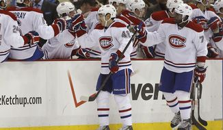 Montreal Canadiens' Daniel Briere (48) is greeted by teammates on the bench after scoring in the second period of an NHL hockey game against the Pittsburgh Penguins, Thursday, Feb. 27, 2014 in Pittsburgh. (AP Photo/Keith Srakocic)