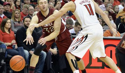 Temple's Dalton Pepper passes around Louisville's Luke Hancock during the first half of an NCAA college basketball game, Thursday, Feb. 27, 2014, in Louisville, Ky. (AP Photo/Timothy D. Easley)