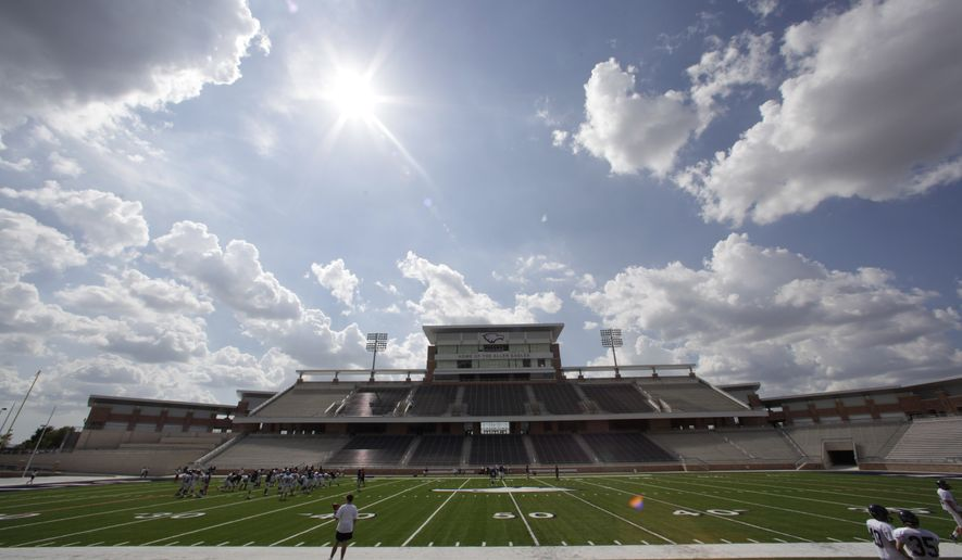 FILE - This Aug. 28, 2012 file photo shows Eagle Stadium at Allen High School in Allen, Texas. The $60 million high school stadium that got national attention for its grandeur _ and its price tag _ will be shut down indefinitely just 18 months after its opening, North Texas school district officials said Thursday, Feb. 27, 2014, for an examination of cracking in the concrete of the stadium's concourse. (AP Photo/LM Otero, File)
