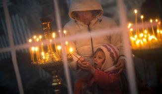 Since Russia's annexation of Crimea in March, religious groups there are facing persecution and restrictions on their ministry. Catholics, Ukrainian Orthodox of the Kyiv Patriarchate and Muslims are all facing persecution from local authorities, and anticipate that they may have to go underground in January, when laws change. (AP Photo/Emilio Morenatti)