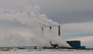 **FILE** Steam rises from the stacks of Basin Electric's Laramie River Station coal-fired power plant near Wheatland, Wyo., on Feb. 11, 2014. (Associated Press/The Casper Star-Tribune, Alan Rogers)