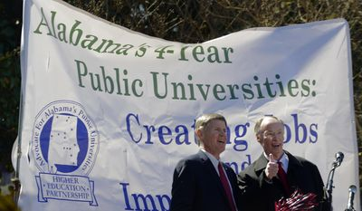 Alabama Governor Robert Bentley, right, gives a thumbs up as he stands with Gordon Stone, Executive Director of the Higher Education Partnership, left, as about two thousand college students from around the state for a Higher Education Day rally, Thursday, Feb. 27, 2014 in front of the Alabama Statehouse in Montgomery, Ala.  (AP Photo/The Montgomery Advertiser, Mickey Welsh)  NO SALES