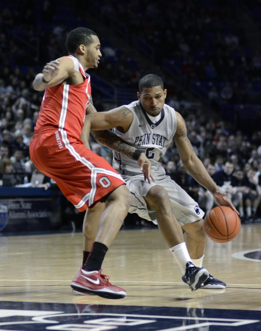 Penn State's D.J. Newbill, right, moves toward the paint around Ohio State's LaQuinton Ross during the first half of an NCAA college basketball game on Thursday, Feb. 27, 2014 in State College, Pa. (AP Photo/Ralph Wilson)