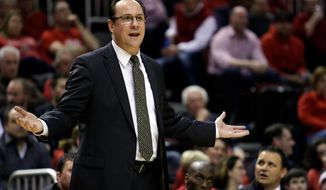 Wichita State head coach Gregg Marshall questions a call during the second half of an NCAA college basketball game against Bradley at Carver Arena, Tuesday, Feb. 25, 2014, in Peoria, Ill. Wichita State won the game 69-49. (AP Photo/ Stephen Haas)