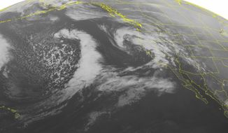 This NOAA satellite image taken Thursday, Feb. 27, 2014, at 2:00 AM EST shows a storm system moving into the southern Pacific Northwest and California with heavy rain. Isolated showers are possible as far west as Arizona and New Mexico. Areas in the highest elevations could have snow showers with this system.(AP PHOTO/WEATHER UNDERGROUND)