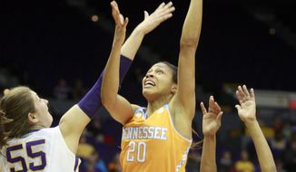 Tennessee center Isabelle Harrison (20) shoots over LSU forward Theresa Plaisance (55) in the first half of an NCAA college basketball game in Baton Rouge, La., Thursday, Feb. 27, 2014. (AP Photo/Tim Mueller)