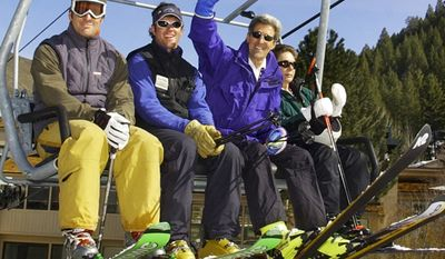 Democratic presidential candidate Sen. John Kerry, D-Mass., and his wife, Teresa, right, ride the chairlift with her son, Chris Heinz, far left, and an unidentified ski patroller during their vacation at Sun Valley in Ketchum, Idaho Saturday, March 20, 2004. (AP Photo/Elise Amendola)