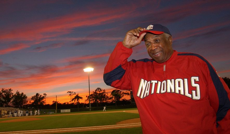 Washington Nationals manager Frank Robinson adjusts his hat before the game against the Los Angeles Dodger in Vero Beach, Fla., Monday, March 28, 2005. (AP Photo/LM Otero)