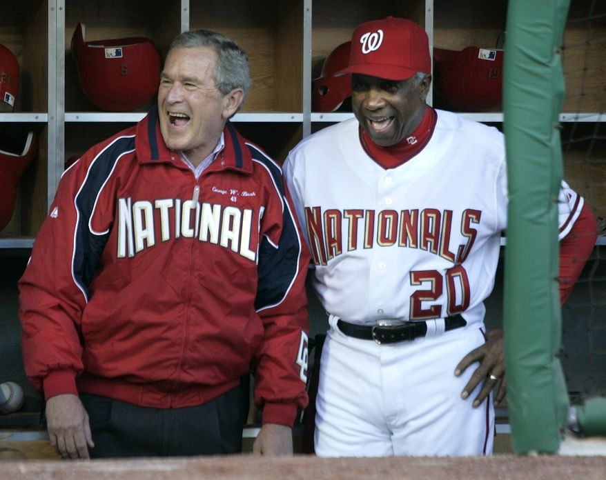 President Bush shares a laugh with Washington Nationals manager, Frank Robinson, before throwing out the first pitch at RFK Stadium in game between the Nationals and Arizona Diamondbacks, Thursday, April 14, 2005, in Washington. It's the Nationals first regular-season baseball game in the nation's capital in 34 years. (AP Photo/Lawrence Jackson)