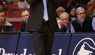 Memphis head coach Josh Pastner calls out a play late in the against  Houston during the second half of an NCAA college basketball game, Thursday, Feb. 27, 2014, in Houston. Houston won 77-68. (AP Photo/Bob Levey)