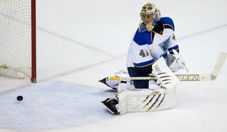 St. Louis Blues' goalie Jaroslav Halak, of Slovakia, allows the only goal of the game to Vancouver Canucks' Jannik Hansen, of Denmark, during third period NHL hockey action in Vancouver, British Columbia, on Wednesday, Feb. 26, 2014. (AP Photo/The Canadian Press, Darryl Dyck)