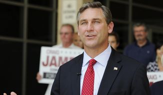 "FILE - In this May 24, 2012 file photo, Texas Republican candidate for the U.S. Senate Craig James gestures during a press conference in Houston. James says Fox Sports hit him with a ""sucker punch"" _ inviting him to join a regional college football show, then firing him and telling the media he was too polarizing for TV. The longtime broadcaster and SMU star has accused Fox of discriminating against him due to his views opposing gay marriage, which he stated during a failed campaign two years ago for U.S. Senate. (AP Photo/Pat Sullivan, File)"