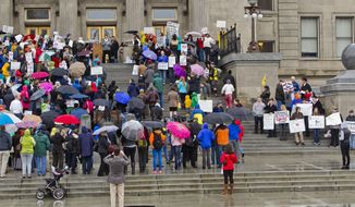 About 300 people gather on the steps of the Idaho Statehouse in Boise, Idaho to protest SB1254, a bill seeking to allow concealed weapons on the state's college campuses, Thursday, Feb. 27, 2014. (AP Photo/The Idaho Statesman, Darin Oswald)  LOCAL TV OUT (KTVB 7)