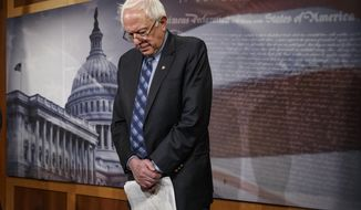 Senate Veterans Affairs Committee Chairman Sen. Bernie Sanders, I-Vt., stands in defeat after a divided Senate derailed Democratic legislation providing $21 billion for medical, education and job-training benefits for the nation's veterans, as the bill fell victim to election-year disputes over spending and whether to slap sanctions on Iran, Thursday, Feb. 27, 2014, on Capitol Hill in Washington. (AP Photo/J. Scott Applewhite)