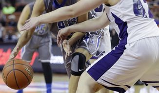 Georgetown's Taylor LaCour, left, is pressured by Canyon's Madison Parker (42) during a girls' UIL Class 4A state basketball semifinal, Thursday, Feb. 27, 2014, in Austin, Texas. Canyon won 41-22. (AP Photo/Eric Gay)