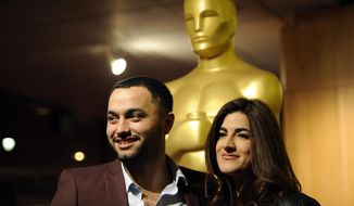 "Jehane Noujaim, right, director of the Oscar-nominated documentary film ""The Square,"" poses with the film's producer Karim Amer at a reception featuring the Oscar nominees in the Documentary Feature and Documentary Short Subject categories on Wednesday, Feb. 26, 2014, in Beverly Hills, Calif. The Oscars will be held on Sunday at the Dolby Theatre in Los Angeles. (Photo by Chris Pizzello/Invision/AP)"