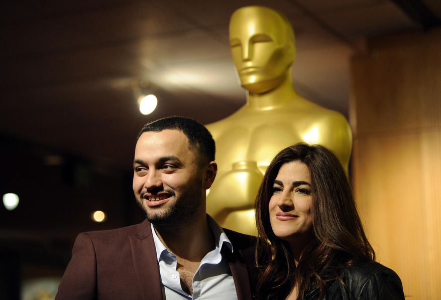 """Jehane Noujaim, right, director of the Oscar-nominated documentary film """"The Square,"""" poses with the film's producer Karim Amer at a reception featuring the Oscar nominees in the Documentary Feature and Documentary Short Subject categories on Wednesday, Feb. 26, 2014, in Beverly Hills, Calif. The Oscars will be held on Sunday at the Dolby Theatre in Los Angeles. (Photo by Chris Pizzello/Invision/AP)"""