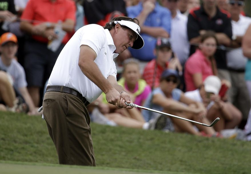 Phil Mickelson chips onto the sixth green during the first round of the Honda Classic golf tournament on Thursday, Feb. 27, 2014, in Palm Beach Gardens, Fla. (AP Photo/Lynne Sladky)