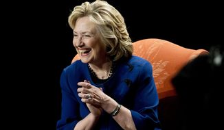 Former secretary of state Hillary Clinton reacts to a question about her future plans after she spoke to a group of supporters and University of Miami students at UM in Coral Gables, Fla., Wednesday, Feb. 26, 2014.  (AP Photo/J Pat Carter)