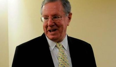 **FILE** Steve Forbes, chairman and CEO and editor in chief of Forbes, talks to reporters after addressing the Ad Week Washington conference in Washington, D.C., on Sept. 17, 2008. (The Washington Times)
