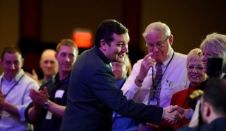 Sen. Ted Cruz (R-Texas) shakes hands before taking the stage to speak at the Tea Party Patriots 5th Anniversary Celebration at the Hyatt Regency Capitol Hill, Washington, D.C., Thursday, February 27, 2014. (Andrew Harnik/The Washington Times)