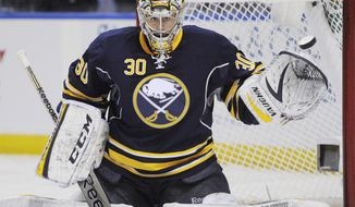 In this Tuesday, Feb. 25, 2014, photo, Buffalo Sabres goaltender Ryan Miller reaches out with his glove to stop the puck during an NHL hockey game against the Carolina Hurricanes in Buffalo, N.Y. Miller, forward Matt Moulson and veteran defenseman Henrik Tallinder are being shopped because their contracts are coming up. (AP Photo/Gary Wiepert)