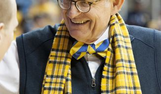 FILE - In this Jan. 11, 2014 file photo, West Virginia's interim president Gordon Gee greets a fan before an NCAA college basketball game between West Virginia and Oklahoma State in Morgantown, W.Va.  A West Virginia University search committee on Friday, Feb. 28, 2014,  did an about-face and endorsed interim President E. Gordon Gee for the job permanently.  The committee made the recommendation during an emergency meeting in Morgantown. The recommendation now goes to the WVU Board of Governors.  (AP Photo/Andrew Ferguson)